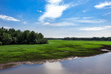 Landscape, river, green field, forest and blue sky