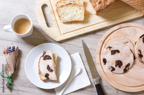 Poster Homemade ham with prunes and homemade wheat bread with seeds
