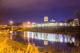 Night landscape of the city with a view of the river and the bridge. Vologda. Russia