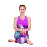 Beautiful girl sitting in a Twist Yoga Pose