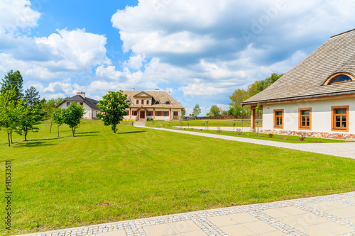 Green park and beautiful traditional houses in Tokarnia village, Poland