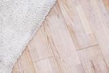 Laminate parquete floor with beige soft carpet - 141550149