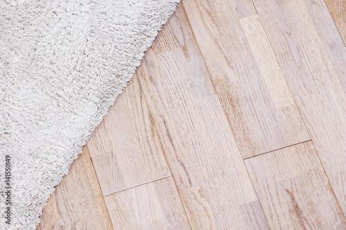 Poster Laminate parquete floor with beige soft carpet