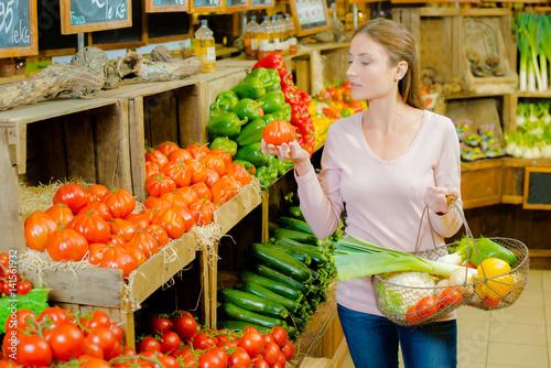 Woman choosing tomatoes