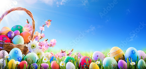 Easter Eggs In Basket And On Meadow