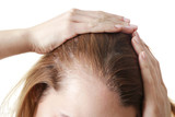 Fototapety Young woman with hair loss problem on white background, closeup