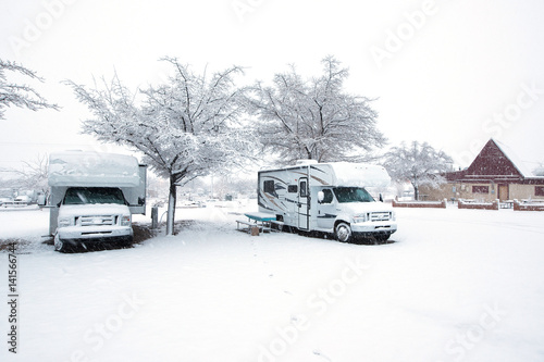 Two RV parked in a campground. - 141566744