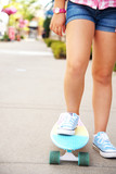 A girl's leg on the scateboard