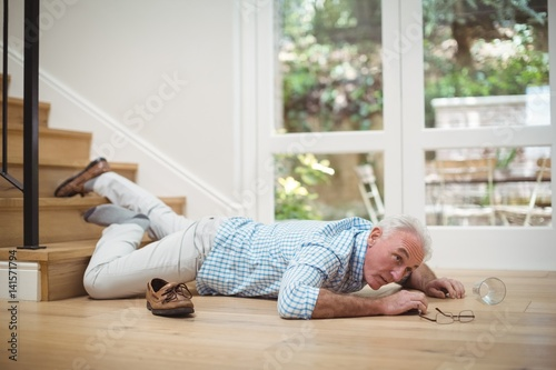 Senior man fallen down from stairs Poster