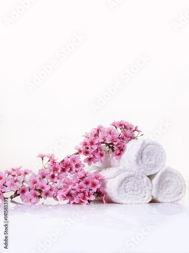 Poster Spa Tropical Spa with blooming branch with towel