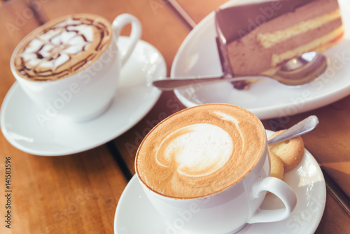 Cappuccino coffee and chocolate mousse cake. Toned image