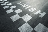 Sunny finish line pattern racing background on the asphalt floor. - 141587175