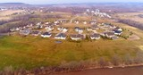 Idyllic neighborhood with nice new houses in rural setting, aerial view.  - 141590755
