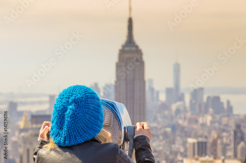 Woman enjoying in New York City panoramic view Poster