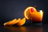 Orange slices and glass of juice