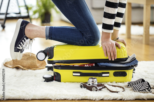 Preparation travel suitcase at home Plakat