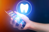 Concept of making an appointement with a dentist on internet - technology concept