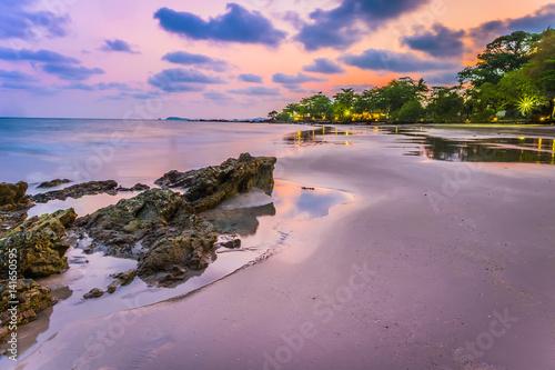 Fotobehang Purper Long Exposure of Sunset at the sea, Suan Wang Kaew, Rayong, Thailand, Sunset at rock beach , Rayong, Thailand
