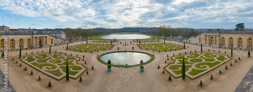 Symmetric french gardens of the Orangerie of Versailles palace in France, panoramic view. - 141659786