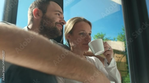 couple relaxing at home with a cup of coffee