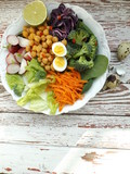 Bowl of Buddha. The concept of healthy vegetarian food. Fresh raw vegetables and boiled chickpeas.
