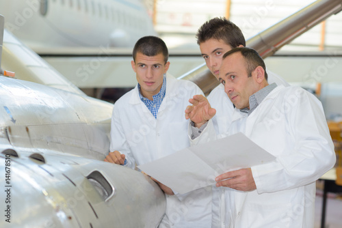 Students next to aircraft