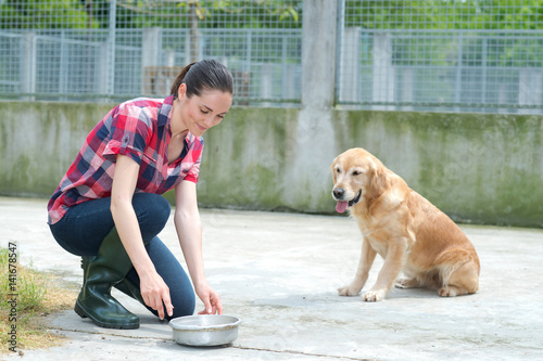 Poster dedicated girl training dog in kennel