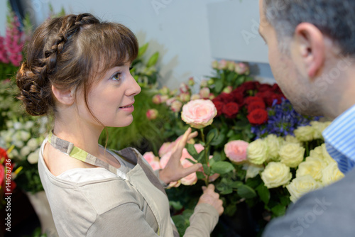 Florist in discussion with customer