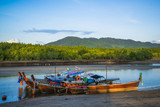 Wooden fisherman boats on river in Thailand