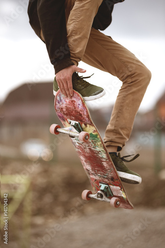 Close-up of skateboarders foot while skating in skate park