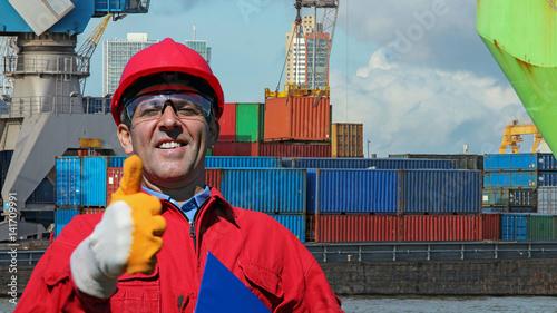 Aluminium Worker Gesturing Thumb Up Near Container Terminal
