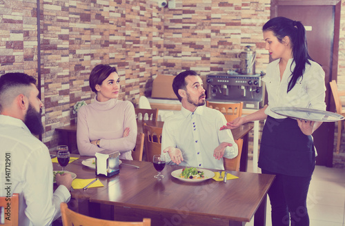 Unpleased client talking with manager in restaurant