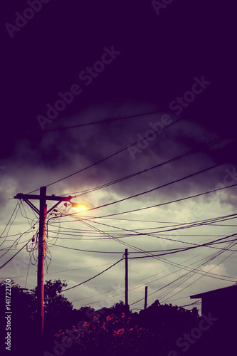 Street light at night with a stormy sky background Poster