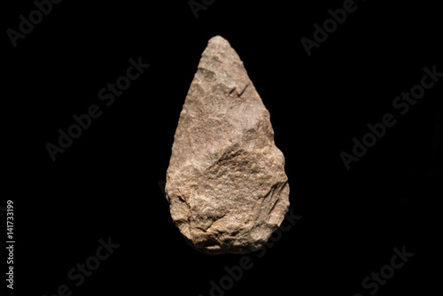 Prehistoric human tool, Quartzite biface on black isolated background, 500 Poster