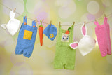 Colorful Easter baby clothes on a clothesline - 141751986
