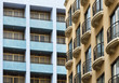 French balconies contrasting with the postmodern architecture of blue balconies