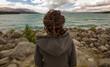 Quadro Rear view of a woman looking at lake, New Zealand