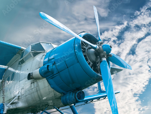 Foto op Canvas Scooter plane with propeller on beautiful bright sky background