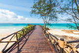 beautiful landscape with wooden stage leading to the clear blue ocean, Africa