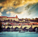 beautiful view of the Charles Bridge and other sights in Prague at sunset, Czech Republic