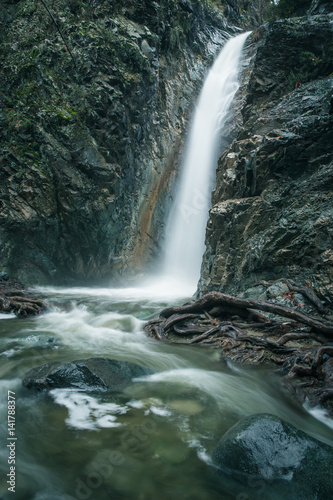 Fototapeta Mountain waterfall at fall