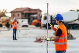 Surveyors on construction site - 141800108