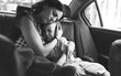 Mother Soothe Her Son Crying in the Car