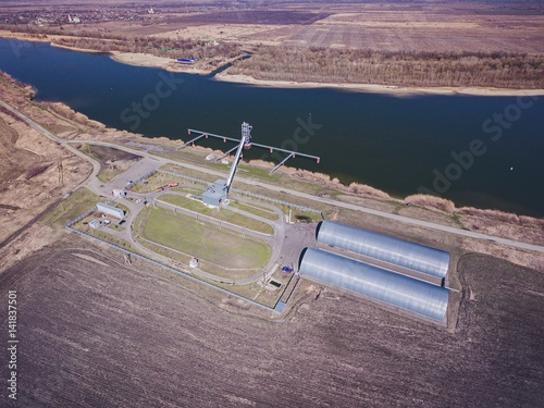 Grain storage silos and grain elevator at the port. Aerial view. Poster
