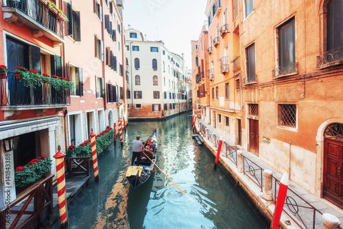 Gondolas on canal in Venice. Venice is a popular tourist destination of Europe.