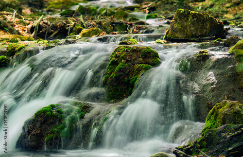 Fototapeta Mountain river with stones with pure thawed water.