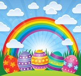 Easter theme with eggs and rainbow