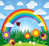 Spring theme with flowers and rainbow