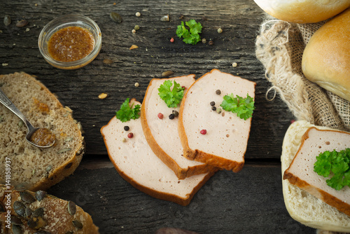 Poster Traditional Bavarian meat loaf with a brown crispy crust pepper parsley  on rust