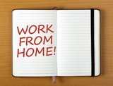 The words Work From Home in red text on the open page of a notebook as a reminder of an aspiration - 141873567